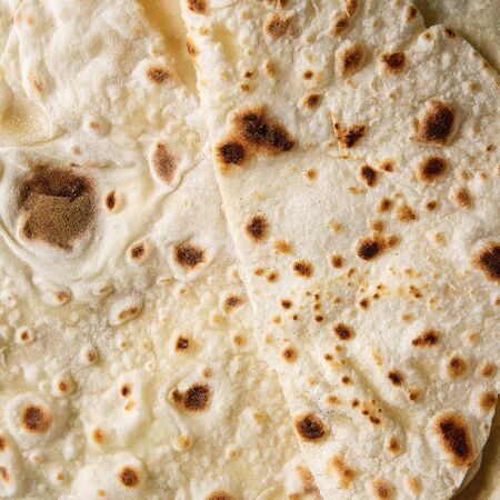 Homemade pita or chapati flatbread flapjack background. Top view, close up. Square image