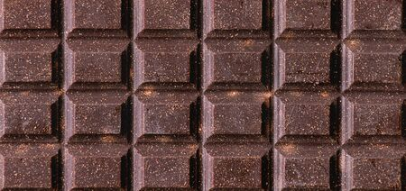Close up ofwhole dark chocolate bar. Food background
