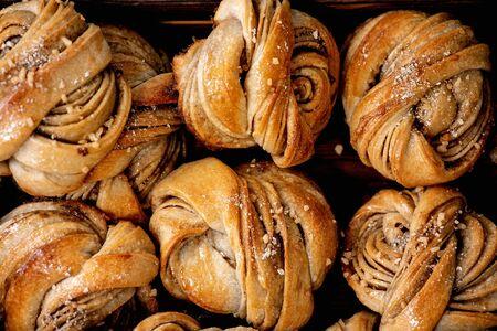 Close up of traditional Swedish cardamom sweet buns Kanelbulle. Flat lay, food background Stock Photo