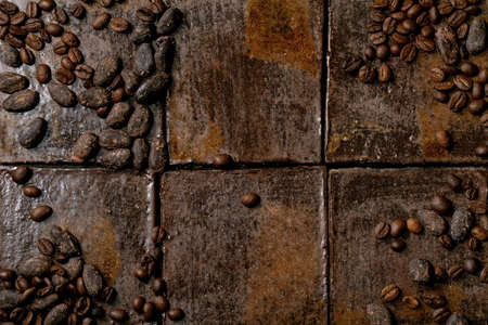 Roasted coffee and cocoa beans over dark ceramic tile as background. Flat lay, copy space 版權商用圖片 - 151055383