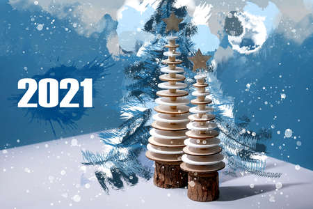 New year 2021 greeting card with wooden trees and waterclolr elements over blue Stok Fotoğraf