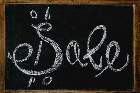 Promotion sale concept. Vintage chalkboard with hand written chalk lettering Sale with percents Stok Fotoğraf