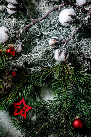 Christmas New year greeting card background with fir tree branches, moss, red balls and stars. Top view Stok Fotoğraf