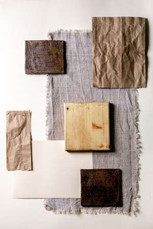 Creative layout abstract geometry empty squares by nature materials paper, textile, wood, ceramics and stone. Flat lay. Space for any products. Advertising business and design eco-friendly concept