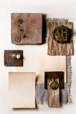 Creative layout geometry squares by nature materials paper, textile, wood, ceramics and stone with old clocks and gears. Flat lay. Space for any products. Advertising business and design time concept