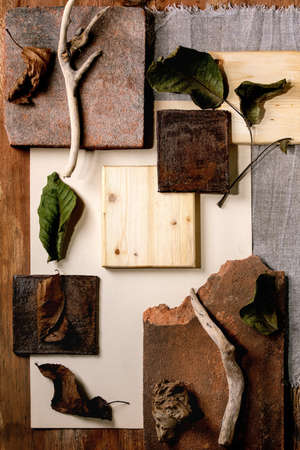 Creative layout abstract geometry empty squares by nature materials paper, textile, wood and stones with dry leaves and branches. Flat lay. Space for any products. Advertising eco-friendly concept Stok Fotoğraf