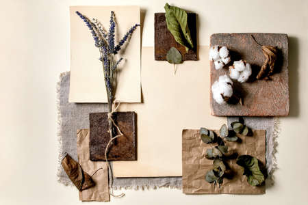 Creative layout abstract geometry empty squares by nature materials paper, textile, wood and stones with dry leaves and flowers. Flat lay. Space for any products. Advertising eco-friendly concept