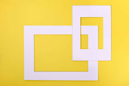 Sinple white paper frames over yellow background. Creative layout. Space for text or design