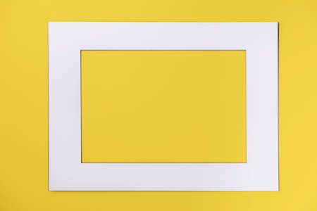 Sinple white paper frame over yellow background. Creative layout. Space for text or design Stok Fotoğraf