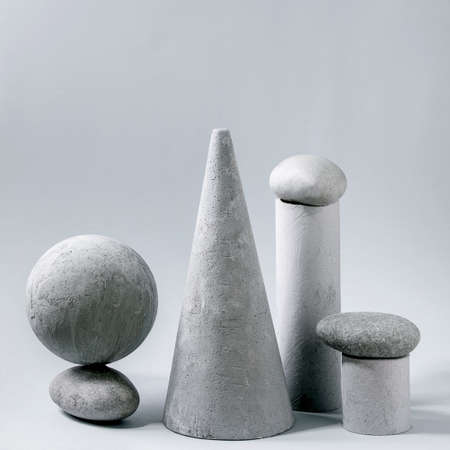 Abstract background with composition of different grey geometric objects and stones. Copy space. Modern concept for product presentation. Square
