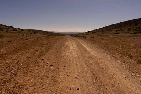 a straight track to the south near sidi ifni, morocco. the road leads to the horizon.