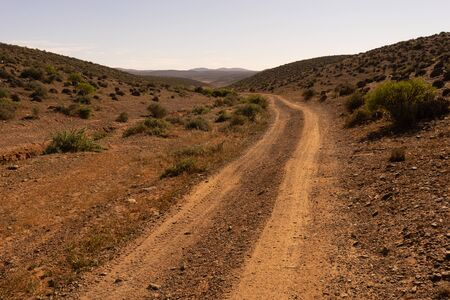 a track to the south near sidi ifni, morocco. the road leads to the horizon.