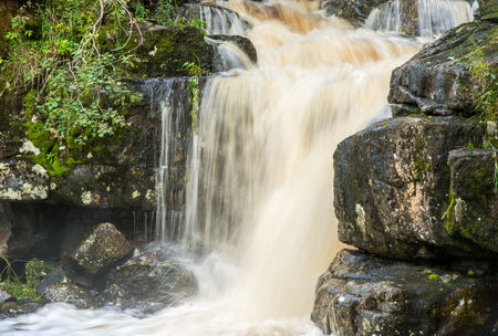 intimately: Small waterfall framed by stone and grnska Stock Photo