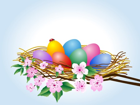 Easter eggs in the nest on branches of cherry tree