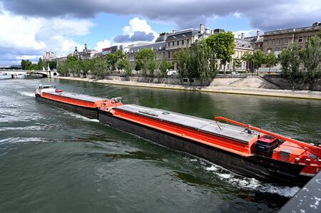Long barge on the Seine river in Paris