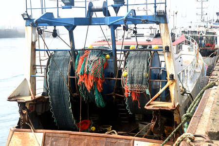 Fishing vessel, trawler in a fishing harbour Stock Photo