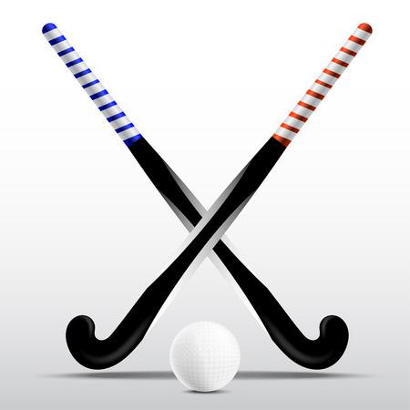 Twee stokken voor hockey en bal op een witte achtergrond
