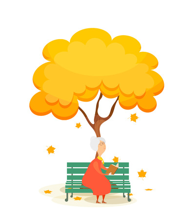 autumn woman: The old woman on the bench. Elderly woman on a park bench, reading a book under a  autumn yellow tree. Falling maple leaves. Autumn time.