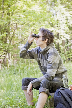 curious: Young man birdwatching