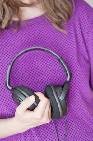 Young woman holding headphones Stock Photo - 11067923