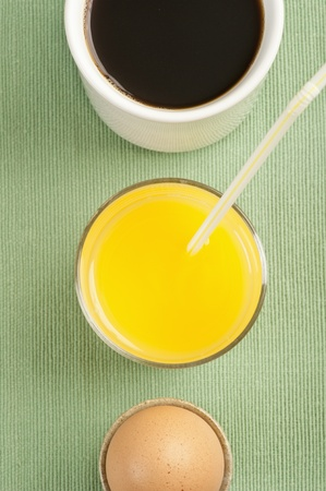 Breakfast with brown egg, orange juice and coffee photo