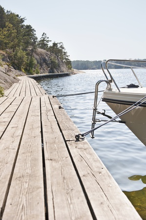 Tranquil scene with boat and jetty, Stockholm Archipelago Stock Photo