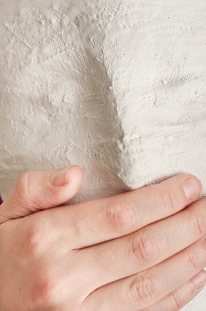 Close up of a white mask with a hand covering the mouth Stock Photo - 11901157