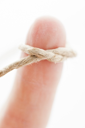Close up of a finger with string tied around Stock Photo