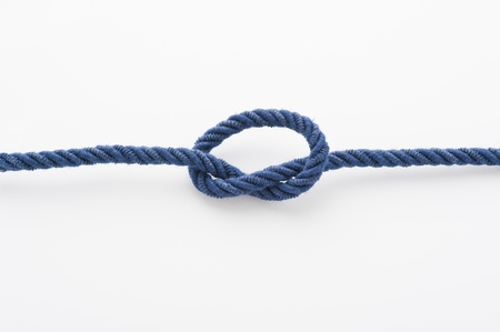 Blue rope with a tied knot in the middle