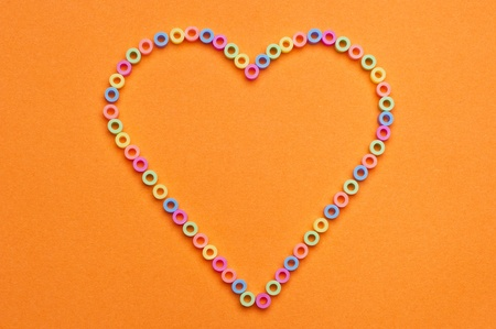 Plastic beads with different colors in the shape of a heart