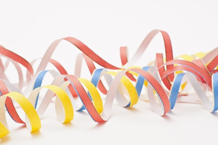 Studio shot of party streamers on white background Stock Photo
