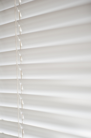 Window with white Venetian Blinds that are shut