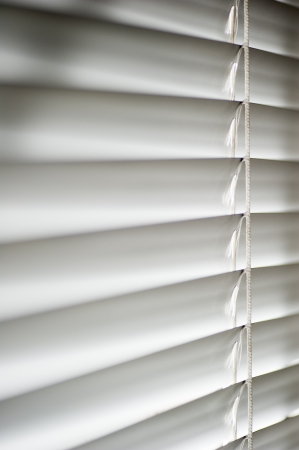 Window with white Venetian Blinds that are shut Stock Photo - 14254562