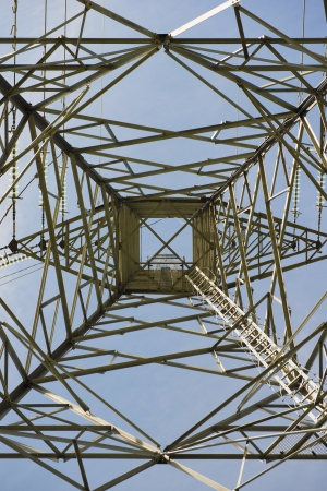 Low angle view of power pylon showing electrical distribution through energy cables Stock Photo - 15193748