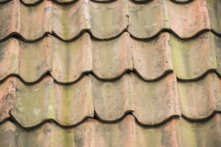 Roof of old house with clay tiles photo