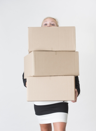Young adult female carry a stack of boxes during a move from one office to another Stock Photo - 15029618