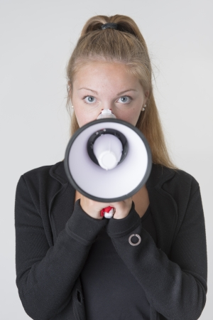 Beautiful businesswoman communicate with a megaphone