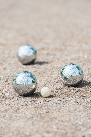 Game of boule being played on sand photo