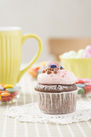 Sweet cupcake with frosting photo