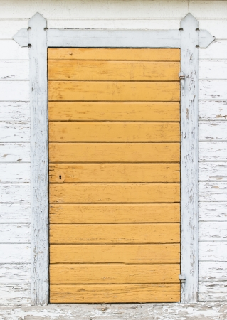 Doorway in wood with weathered look at front of building Stock Photo - 16493836