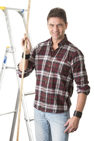 Isolated portrait of male contractor holding a long rule photo