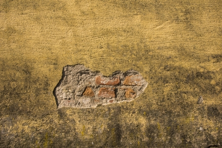 Old fashioned house exterior with weathered rough surface on the wall Stock Photo - 16935340