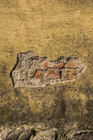 Old fashioned house exterior with weathered rough surface on the wall Stock Photo - 16935341