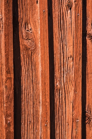 Seamless closeup of red wall on retro building. Striped wooden panels which make a nice surface with rough texture. Stock Photo - 16935344
