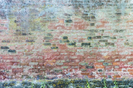 Old fashioned house exterior with weathered rough surface on the wall Stock Photo