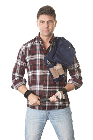 Isolated portrait of carpenter holding hammer and tool belt photo
