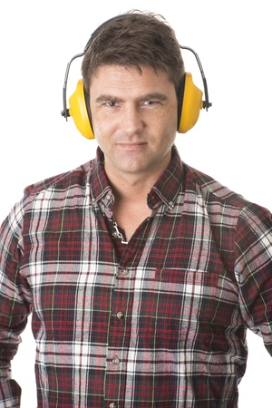 Isolated portrait of male builder or handyman with protective earplugs photo