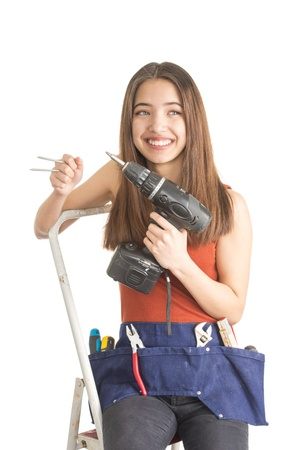 Beautiful teenage girl hold tool for home improvement