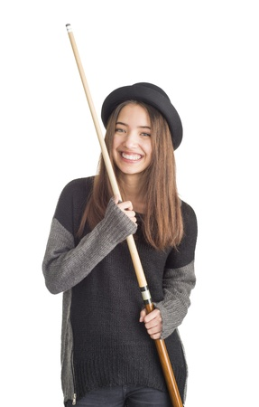 Beautiful teenage girl playing billiards, snooker or pool Stock Photo