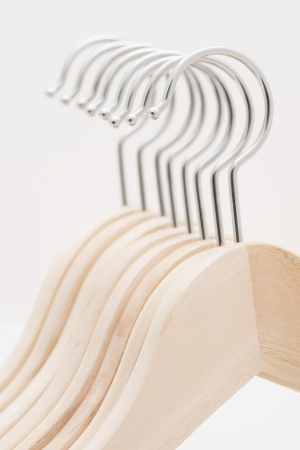 Detail of coat hangers made of wood in a row photo